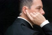 25307680-close-up-of-a-secret-service-agent-listening-to-his-earpiece-side