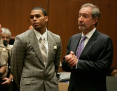 LOS ANGELES, CA - JUNE 22: Singer Chris Brown (L) and attorney Mark Geragos appear at a preliminary hearing at Superior Court of Los Angeles County on June 23, 2009 in Los Angeles, California. The preliminary hearing is to determine if Chris Brown will stand trial for allegedly attacking pop singer Rihanna, during an argument in a rented Lamborghini sports car following a pre-Grammy Awards party on February 8, 2009. He is currently free on $50,000 bail. (Photo by Lori Shepler-Pool/Getty Images)